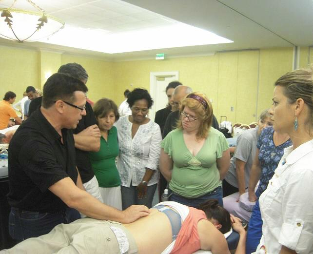 Dr. Ross Turchaninov gives a short review of the sports massage technique before the hands-on training
