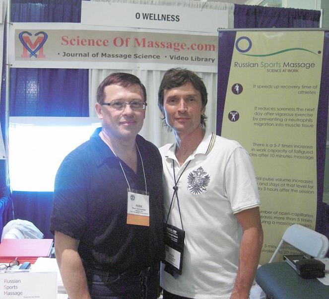 O. Buoimer (right) and Dr. Ross Turchaninov (left) in front of the Science of Massage booth